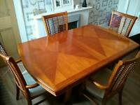 Solid wood dining table and chairs.