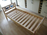CHILDS PINE BED BY IKEA WITH ATTRACTIVE HEADBOARD - HARDLY USED