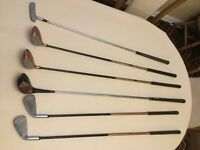 Junior golf clubs. Six in total including putter, 2 irons. All used but in reasonable condition.
