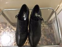Brand new really leather black shoes only £25