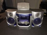 Sharp stereo speaker system featuring tape deck and 3 cd tray autochanger (no remote)