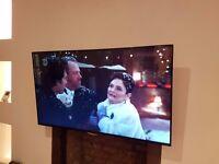 "LG 49"" ULTRA HD TV & LG 2.1 Ch 300W Soundbar with Wireless Subwoofer inc wall bracket"