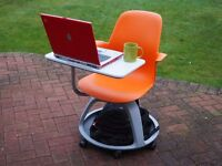 Ten mobile chairs with integral work surface