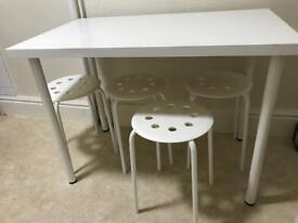 Table and stools and chair