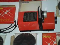 """""""PLUTO"""" 150, COLOUR/PICTURE/OIL-WHEEL PROJECTOR, COMPLETE WITH 6 WHEELS. DATING FROM THE 1970s."""
