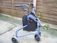 Mobility walker with breaks and bag.