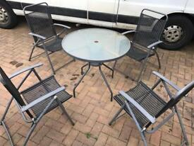 Patio Glass Top Table & folding chairs. Good condition.