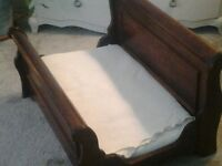 Beautiful pet bed. Ample room for a large dog or two cats. Solid wood, thick foam mattress.