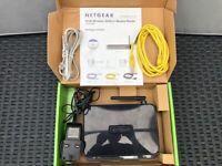 £2 *NETGEAR* DGN1000 wireless modem router.