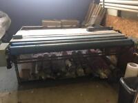 Fabric measuring and cutting machine