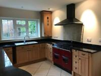 Kitchen, granite work top and AGA Rangemaster