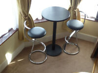 NEW Tall Poseur table dark wood effect with 2 new Dena chrome chairs with black faux leather seats