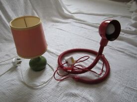Two small desk lamps – green ceramic bed lamp with pink shade and a red reading lamp with flexible..