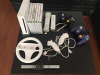 Nintendo Wii bundle with games including Zelda and Mario Kart