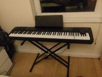 Casio cdp 120 with Tiger stand, pedal and detachable music book stand.