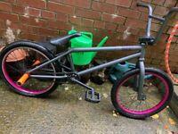 Black Vintage BMX with Orange Pegs