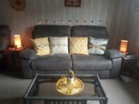 Four piece corner suite with two recliners