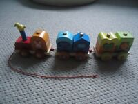 Janod Wooden pull along train with shapes to sort