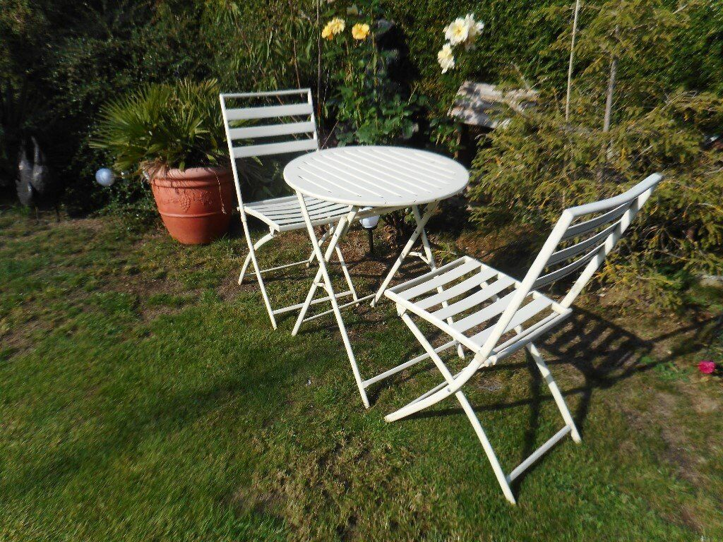 Two white folding garden chairs and matching table cambridge