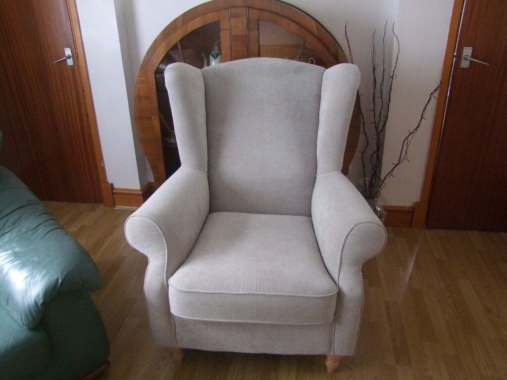 Light taupe wing arm chair
