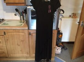 BEAUTIFUL BLACK DRESS BRAND NEW WITH TAGS size 10/12. Lacy black panels. Invisible zip. BARGAIN.