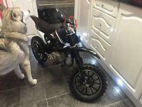 50cc mini dirt bike. Runs and rides