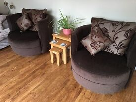 Two swivel living room chairs