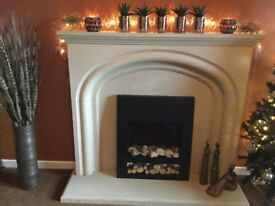 Modern limestone fireplace in immaculate condition