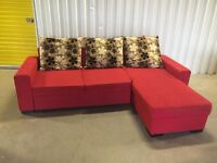 Corner sofa bed red fabric in good condition - left or right - storage space // free delivery