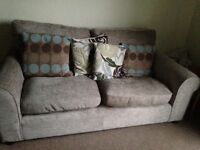 Argos two seater sofa and armchair.light beige colour .only one year old .good clean condition