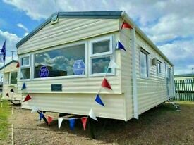 Cheap static caravan for sale sited in essex includes 2021 pitch fees ! beach access