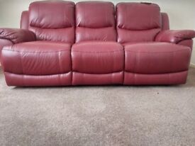 Rich red leather D.F.S 3seater sofa. Safety labels attached. Double manual recliner. Excellent cond.