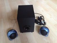Subwoofer and two small speakers by Sony.