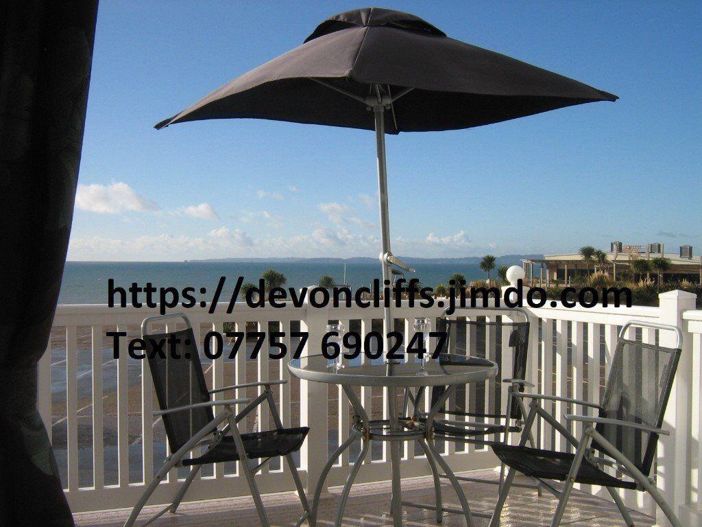 Two bedroom caravan with veranda on front row for hire devon cliffs sandy bay exmouth devon