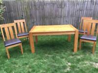 Solid oak dining table and 4 leather chairs