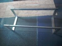 Plate glass coffee table mounted on stainless steel frame in excellent condition