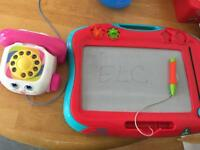Baby ringing phone and white board