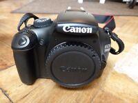 Canon EOS 1100D SLR body.