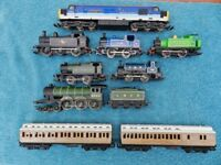 Collection of Hornby 00 engines, trucks and track with other accessories.