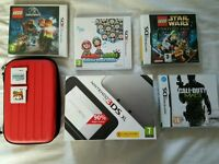 Nintendo 3ds boxed with games and case (excellent condition)