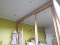 Beautiful large built in wardrobe with sliding mirrored doors