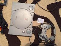 Sony PlayStation + 3 games