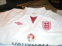 Lots of new England football tops, track suit bottoms, shorts, socks, jackets