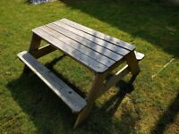 Wooden picnic bench with hidden sandpit/water play