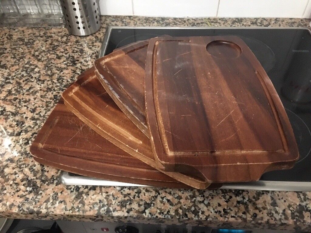 Four wooden chopping boards used
