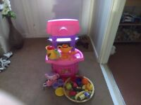 Toy cooker by Barbies, has opening oven, moving tap. Also included kettle, teapot, toy food etc.
