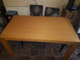 a lovely house of fraser sturdy table that fits 6 to eight chairs.