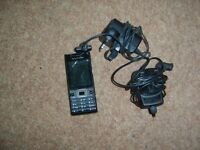 sony ericson phone with 2 chargers
