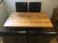 Solid Oak Dining table 120cm x 72cm and 4 black faux leather chairs