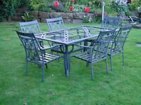 garden table and six chairs made of metal glass missing and cushions could be made